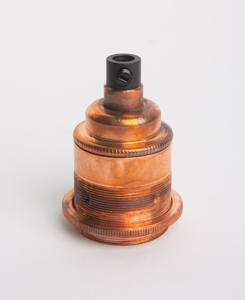 tarnished copper threaded e27 bulb holders against white background