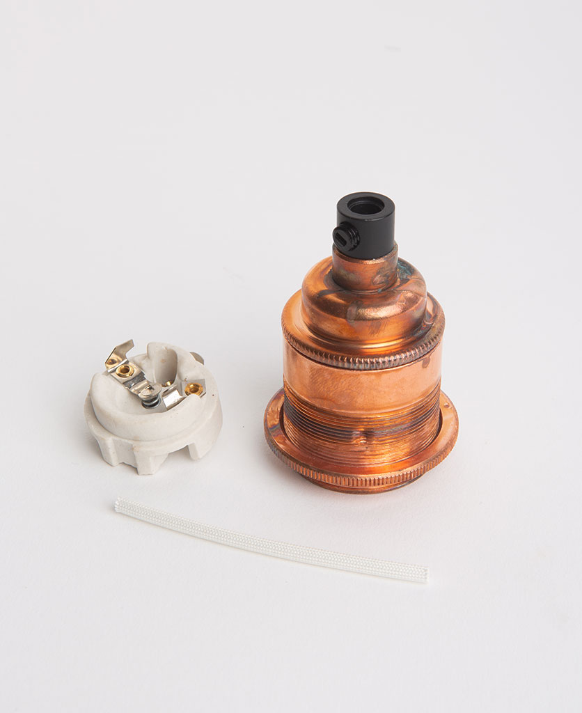 tarnished copper threaded e27 bulb holders with porcelain insert against white background
