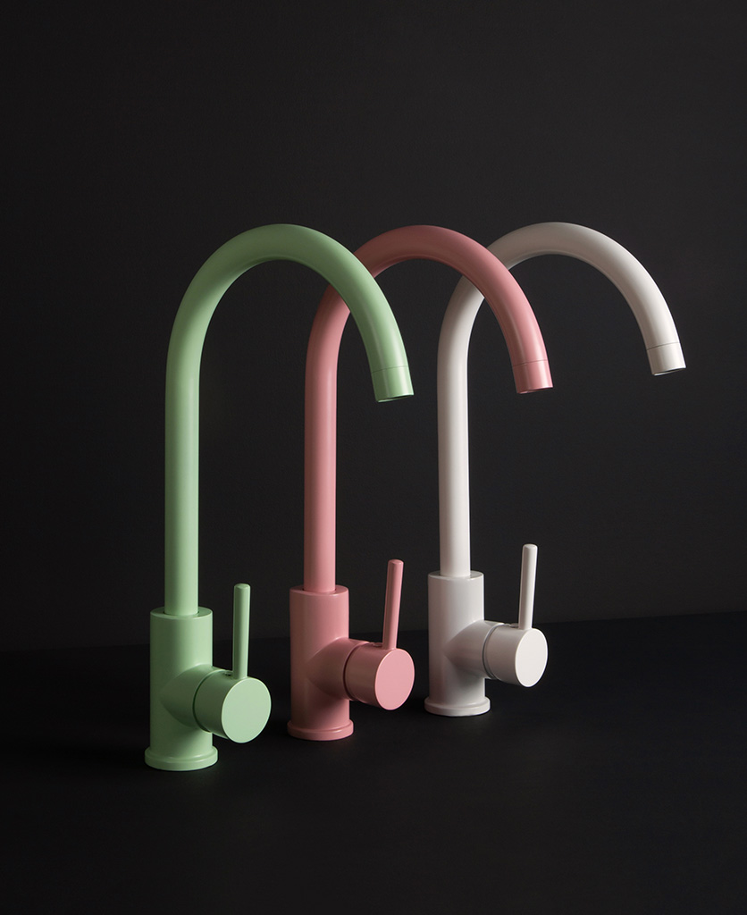 Tinkisso coloured kitchen sink taps Green, pink and white taps side by side on black background side view