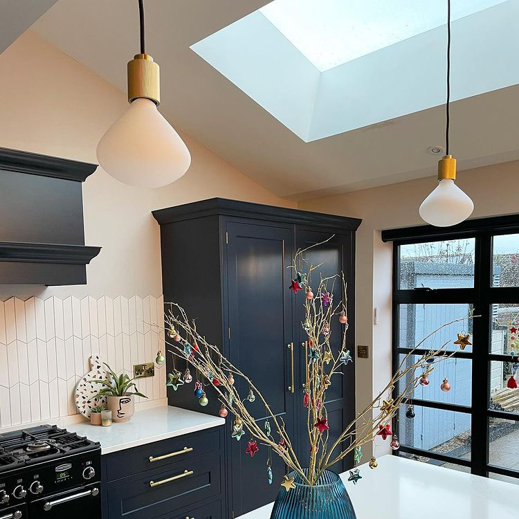 lanesborough pendant light with Nova bulbs suspended above a kitchen island