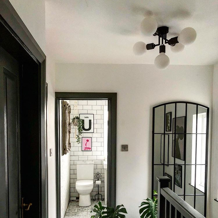 connaught pendant light in a white and black hallway