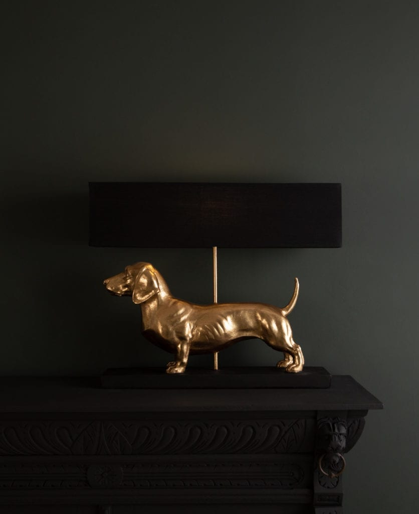 fred dachshund table lamp against black background