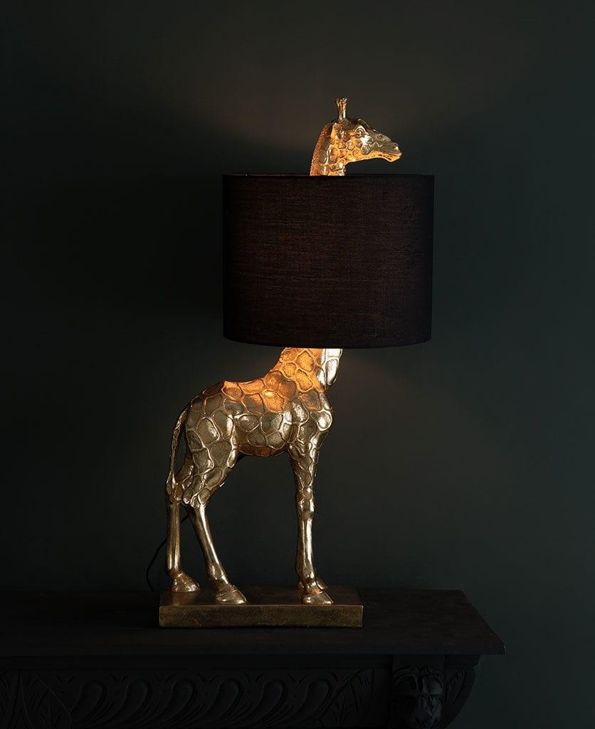 sky giraffe table lamp against black background