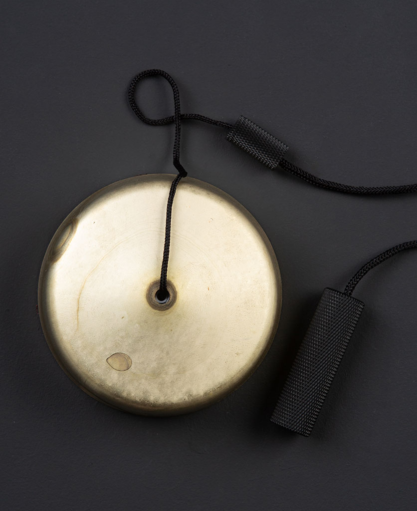 smoked gold pull cord switch with black pull against black background
