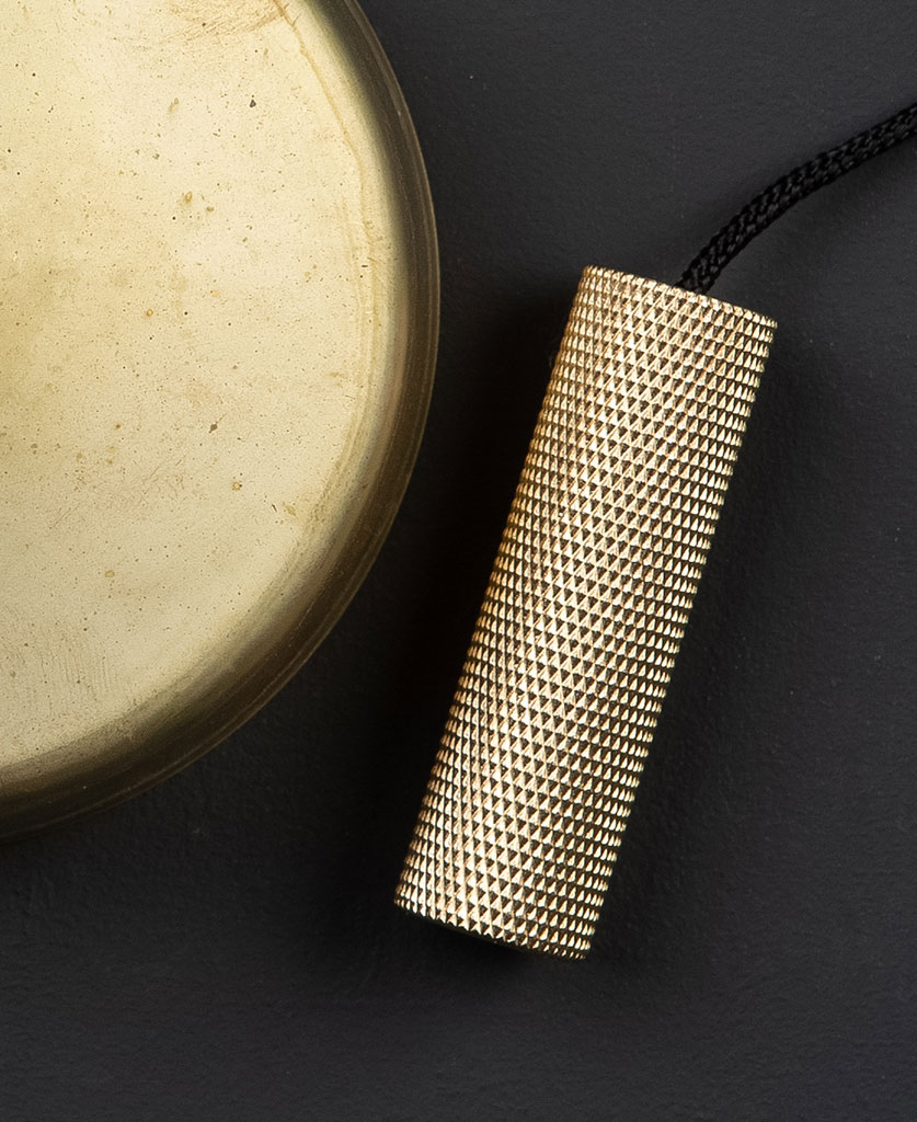 smoked gold pull cord swith with gold pull detail against black background