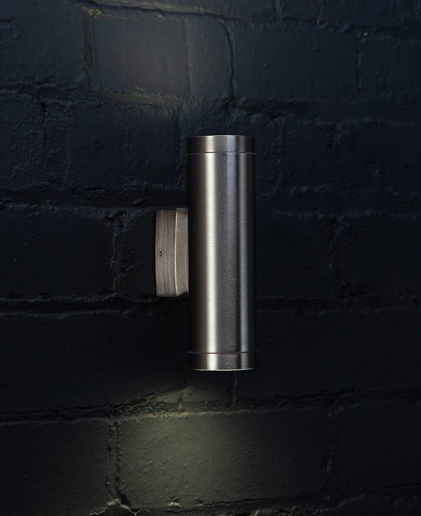 Vega Garden Light Silver on black painted brick wall