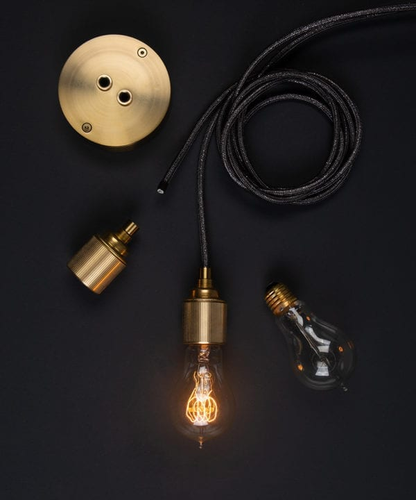 custom ceiling light components assembled on a black background