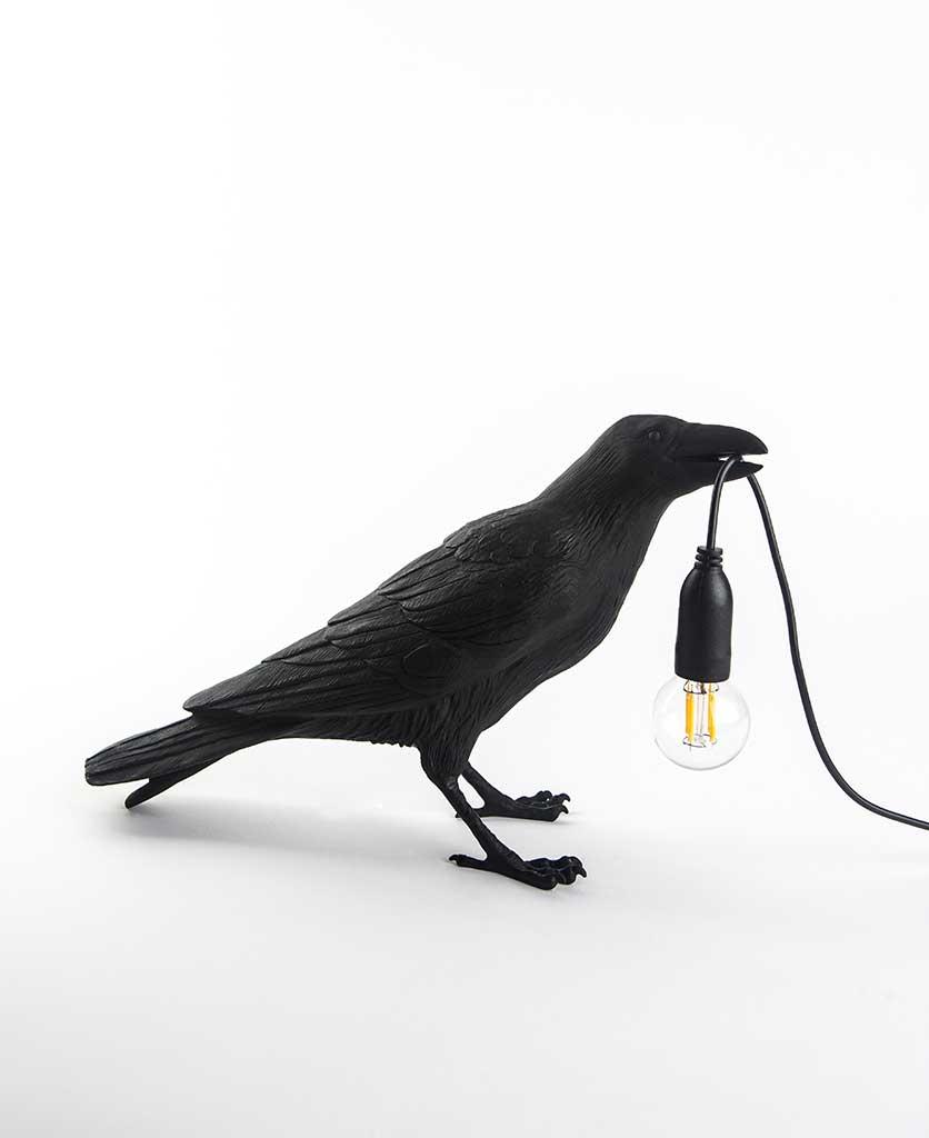 Daphne waiting raven black resin bird lamp holding bulb on white background