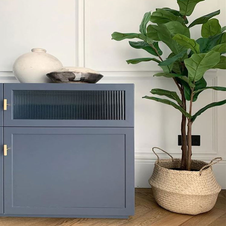 soft blue sideboard in white panelled hallway