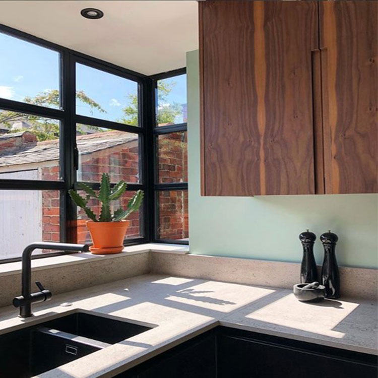 neo mint kitchen with crittal style windows and dark wood cupboards