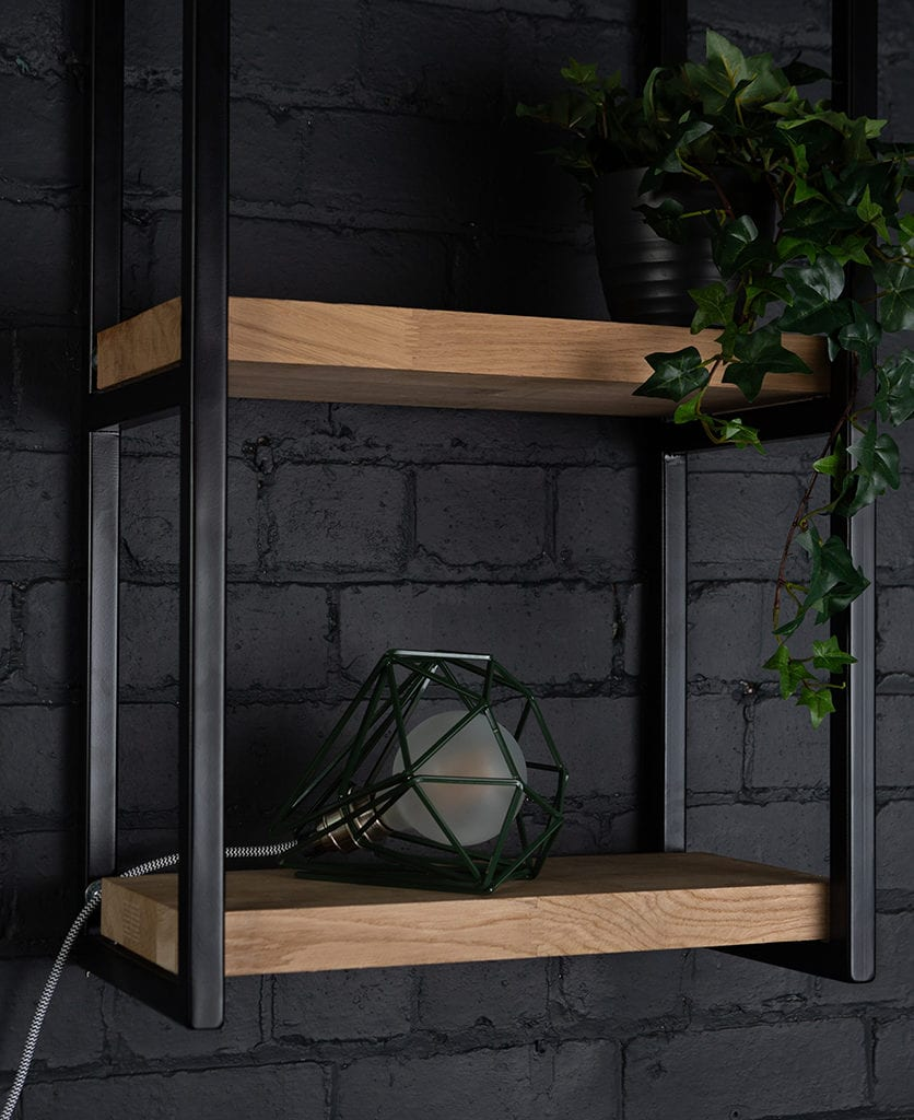 knox shelf brackets on black painted brick wall with matcha table lamp and faux fern
