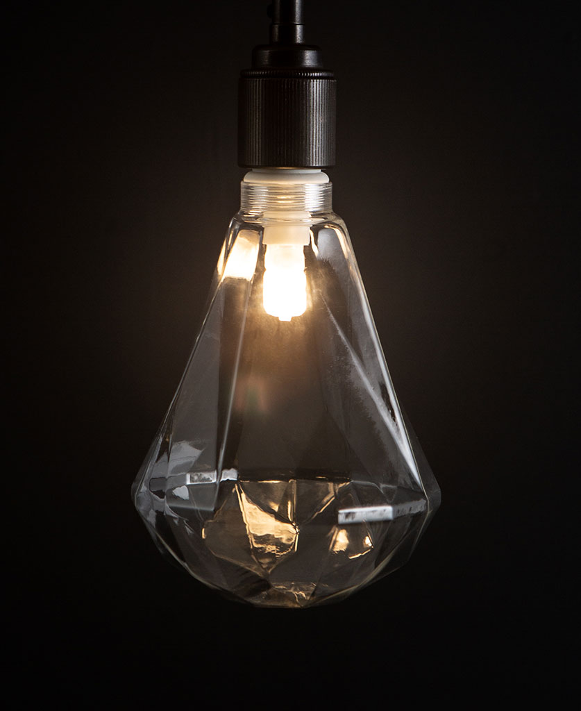 lit clear diamond geometric decorative led light bulbs against black background