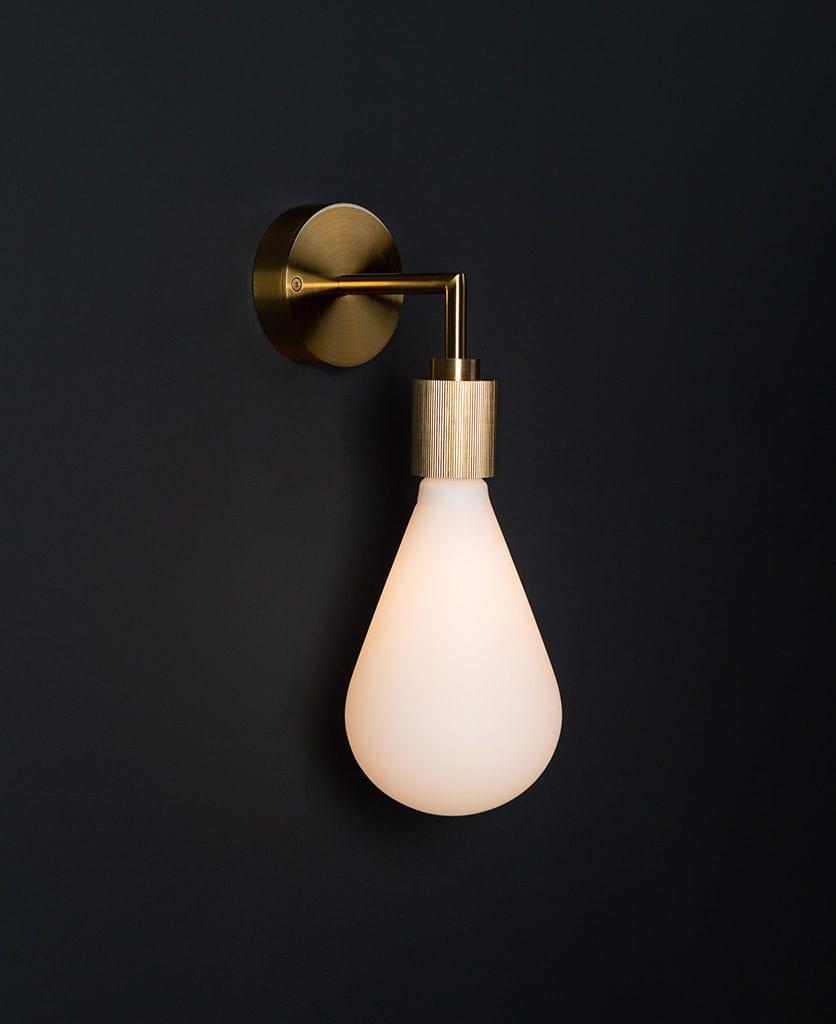 Grosvenor gold wall light against black background