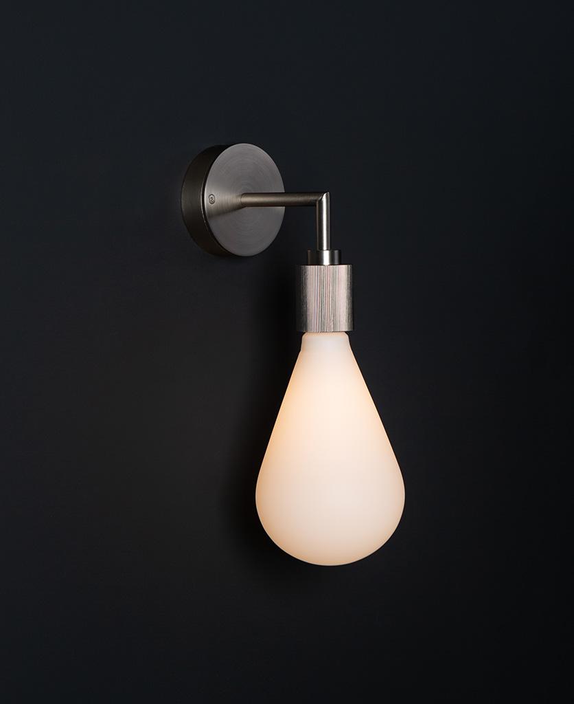 Grosvenor silver lit wall light fixture against black background
