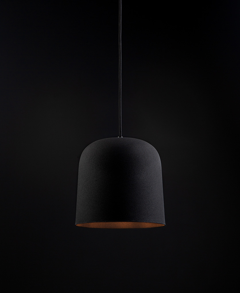 visby black kitchen pendant lights suspended from black fabric cable against black background
