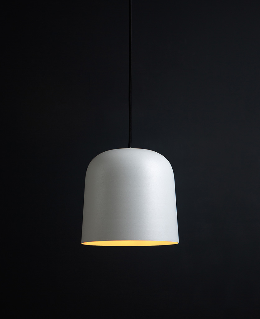 visby white kitchen pendant lights suspended from black fabric cable against black background