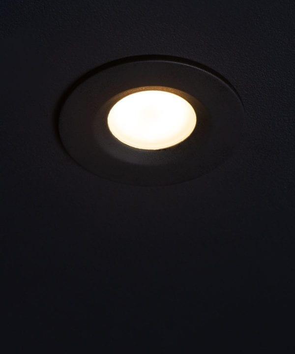 GU10 bulbs downlighter against black ceiling