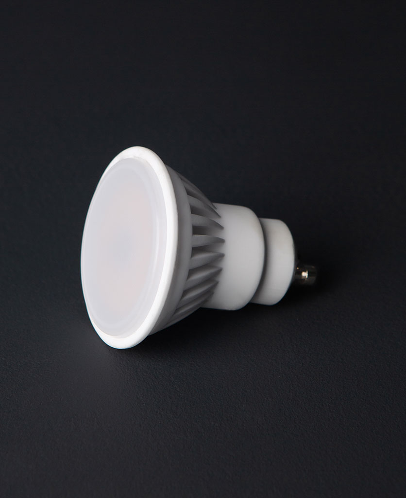 GU10 downlighter bulb against black background