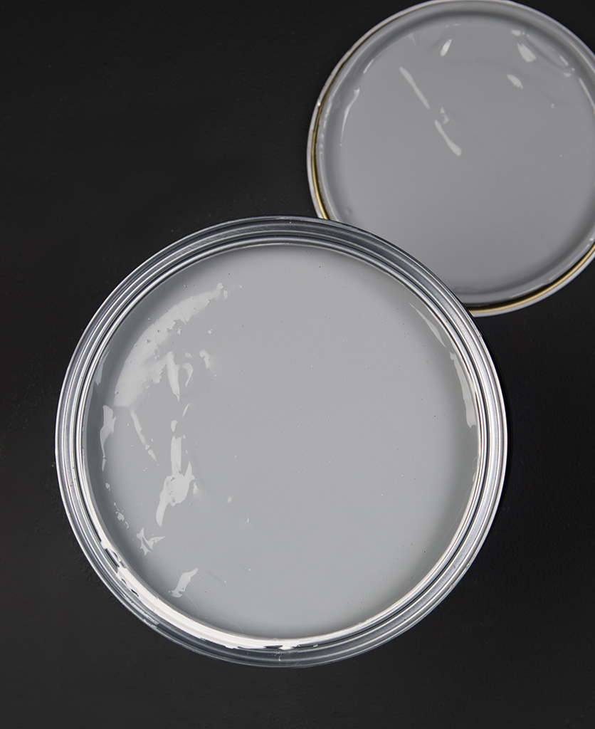 Grey paint primer tin on black background