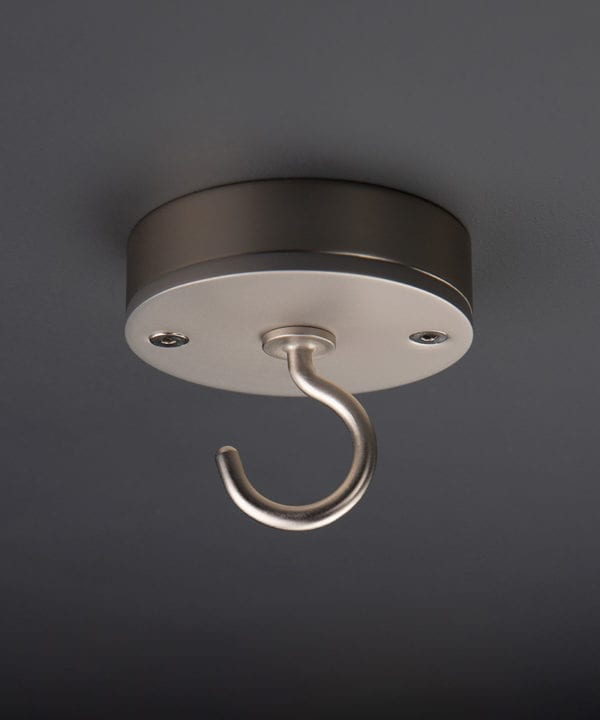 silver ceiling hook against black background