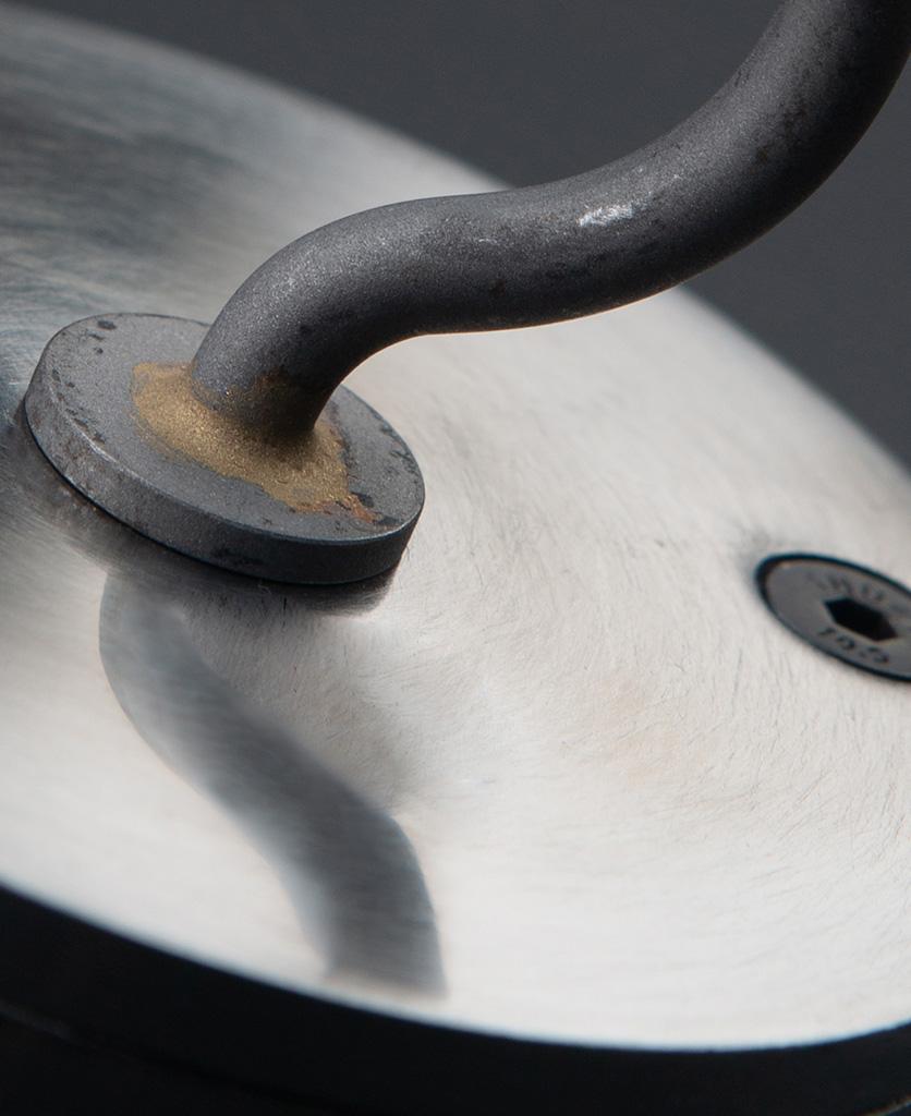 closeup of raw steel ceiling hook