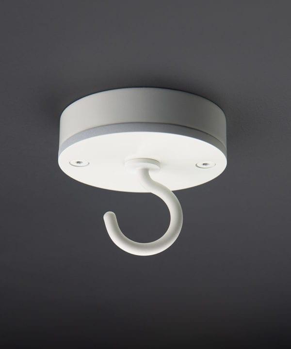 white ceiling hook against black background