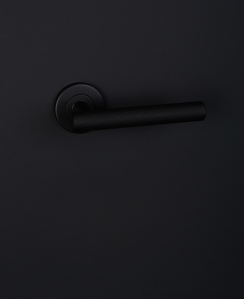 Modern door handle black on black wall