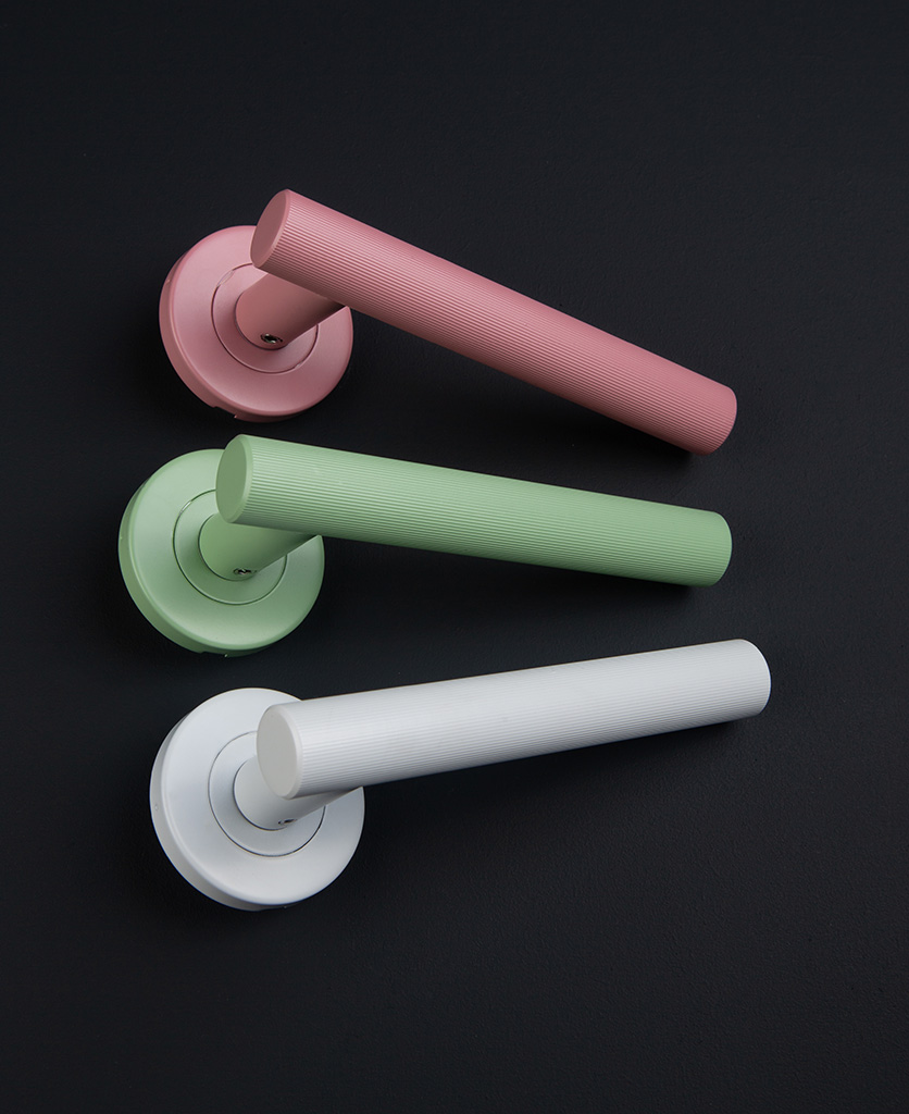 Kramer colour pop door handle group shot with miami pink, neo mint and white handle on black background