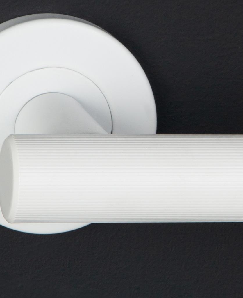 closeup kramer door handle in white on black background