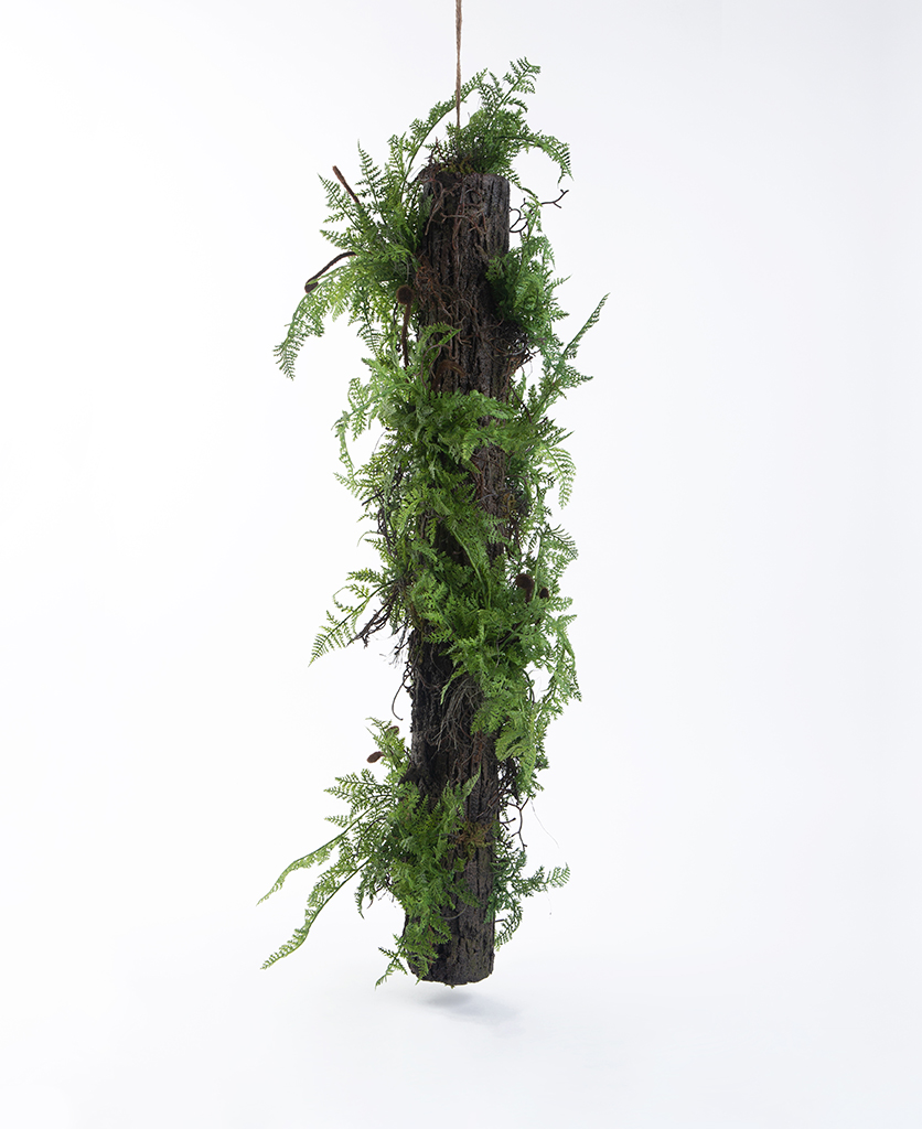large artificial log with ferns