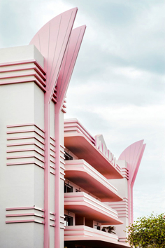 photo of Miami Art Deco style building painted in white with pink details