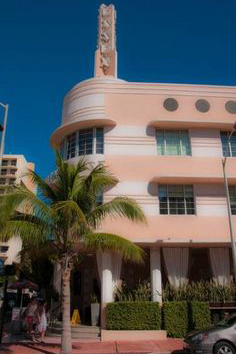 photo of Art Deco style building in Miami painting in white and pink