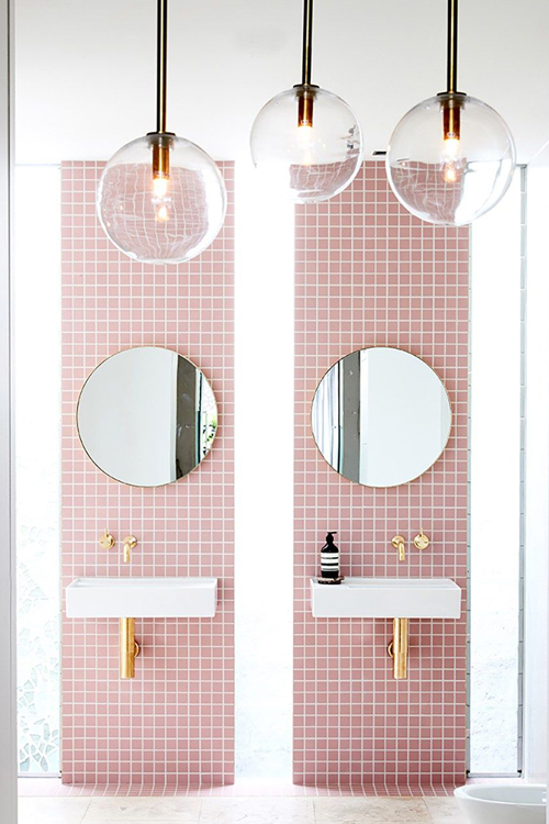 gold colourful taps in miami pink bathroom