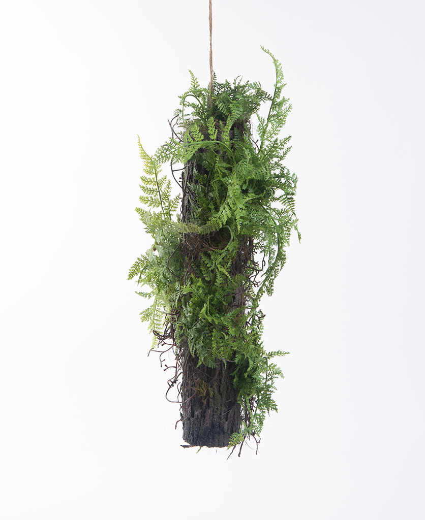 small artificial log with ferns