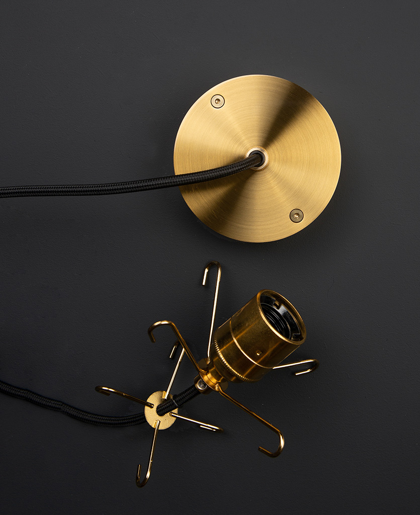 gold one-point ceiling rose with matching bulb holder on black background