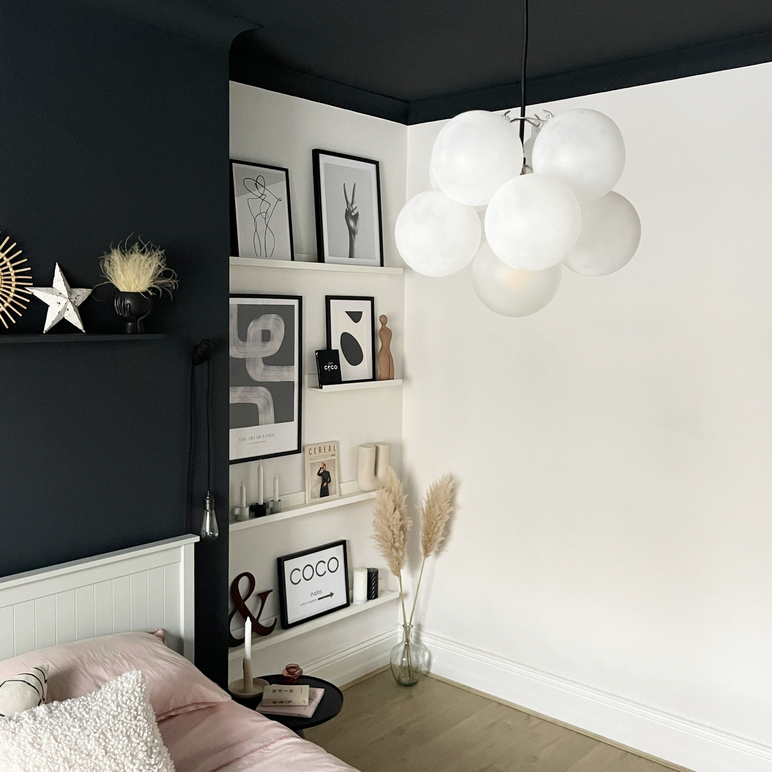 small frosted bubble chandelier in black and white painted bedroom