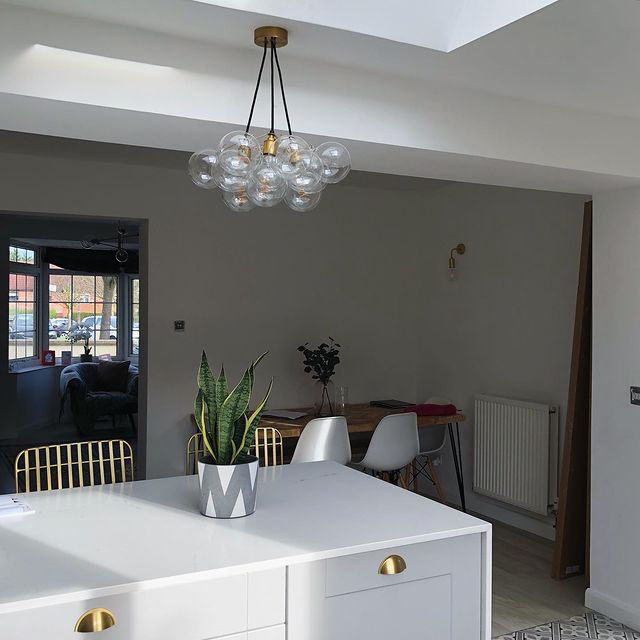 medium bubble chandelier suspended above kitchen island
