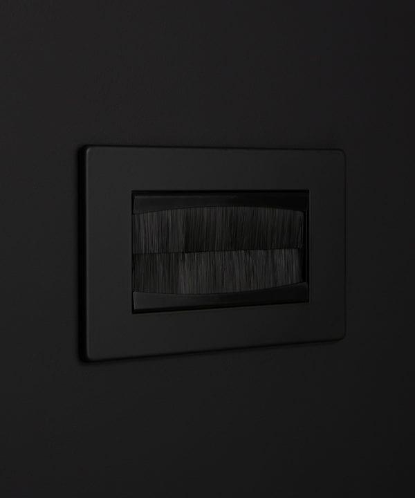 black & black double brush plate against black background