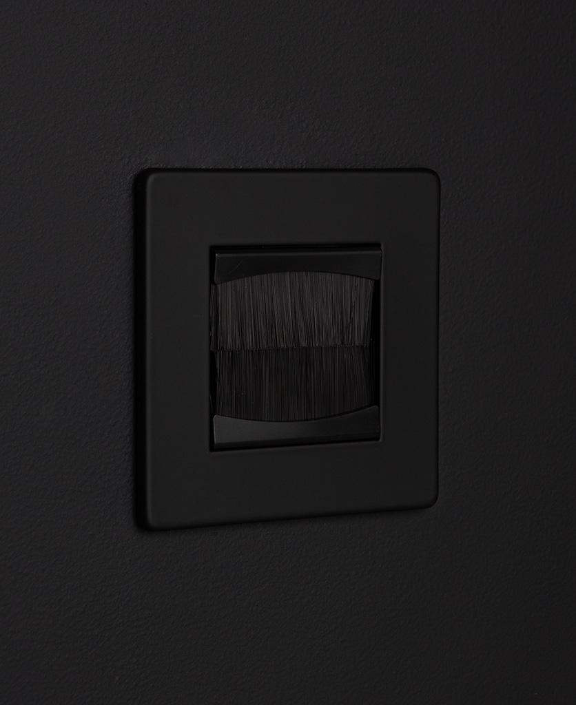 Black brush plate against black background