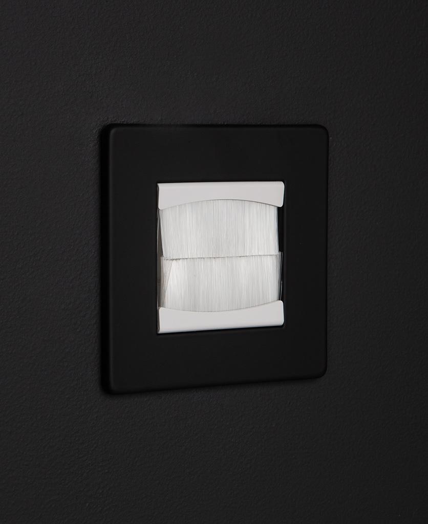 black & white single brush plate against black background