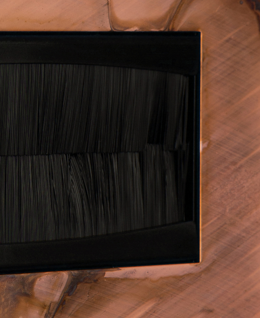 closeup copper & black double brush plate