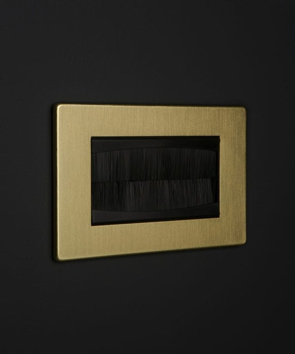 gold & black double brush plate against black background
