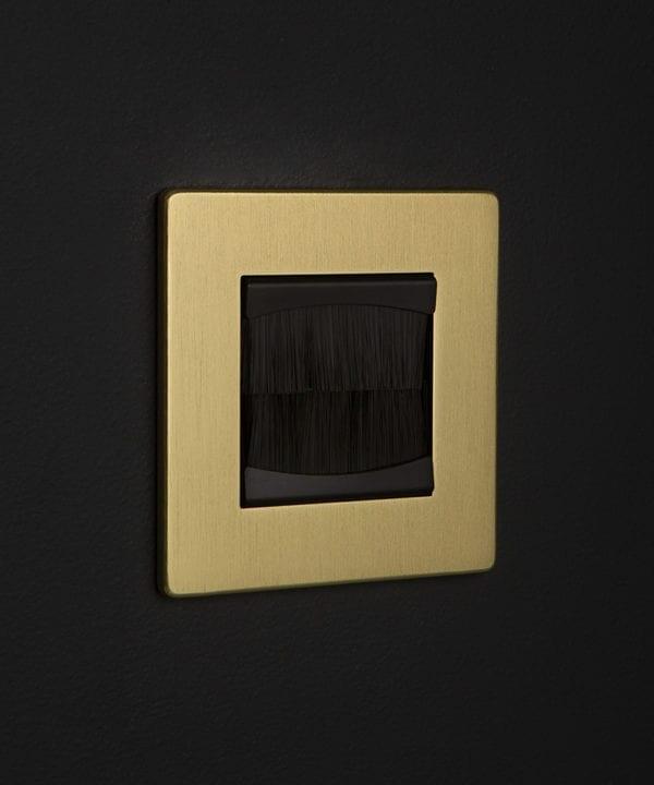gold & black single brush plate against black background