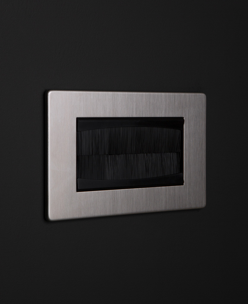 silver & black double brush plate against black wall