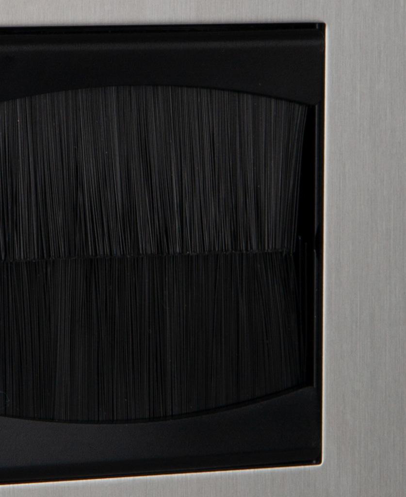 closeup silver & black single brush plate