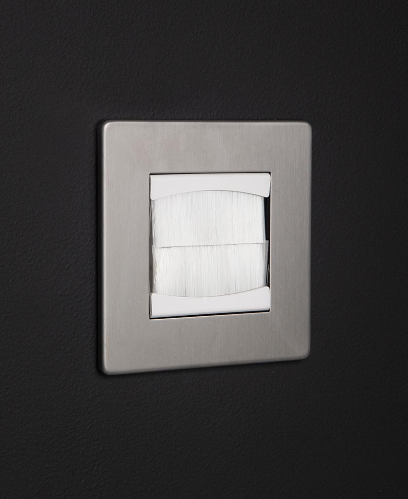 silver & white single brush plate against black background
