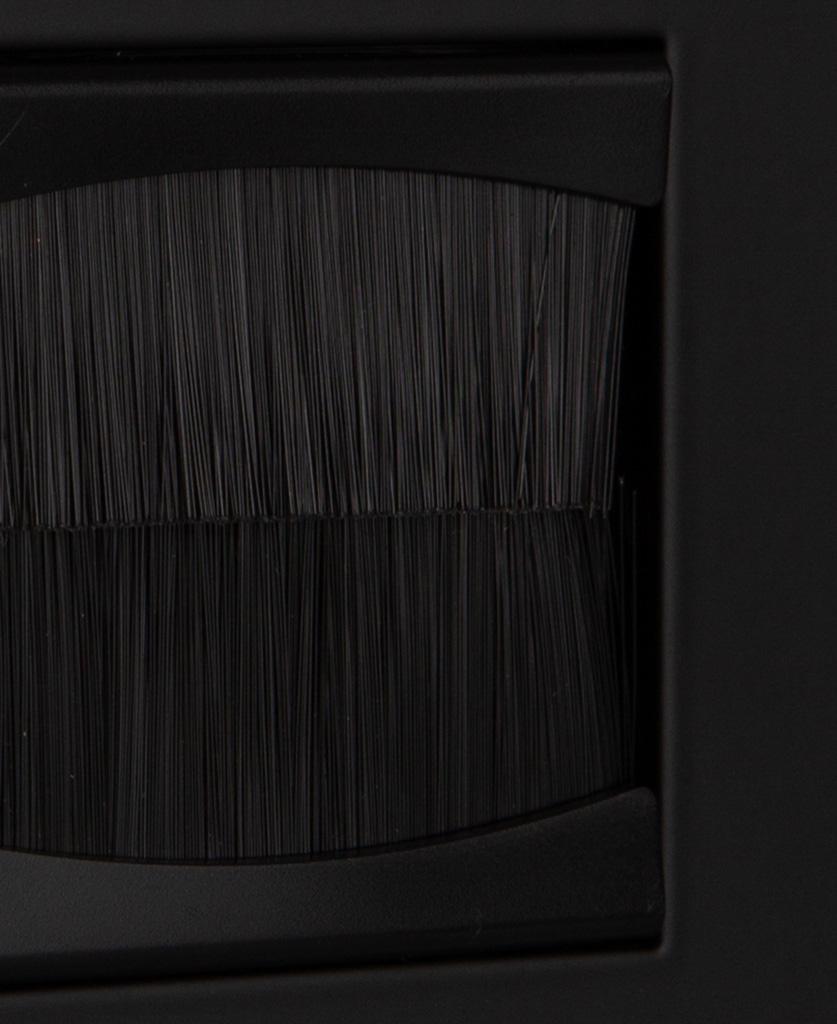 closeup black single brush plate