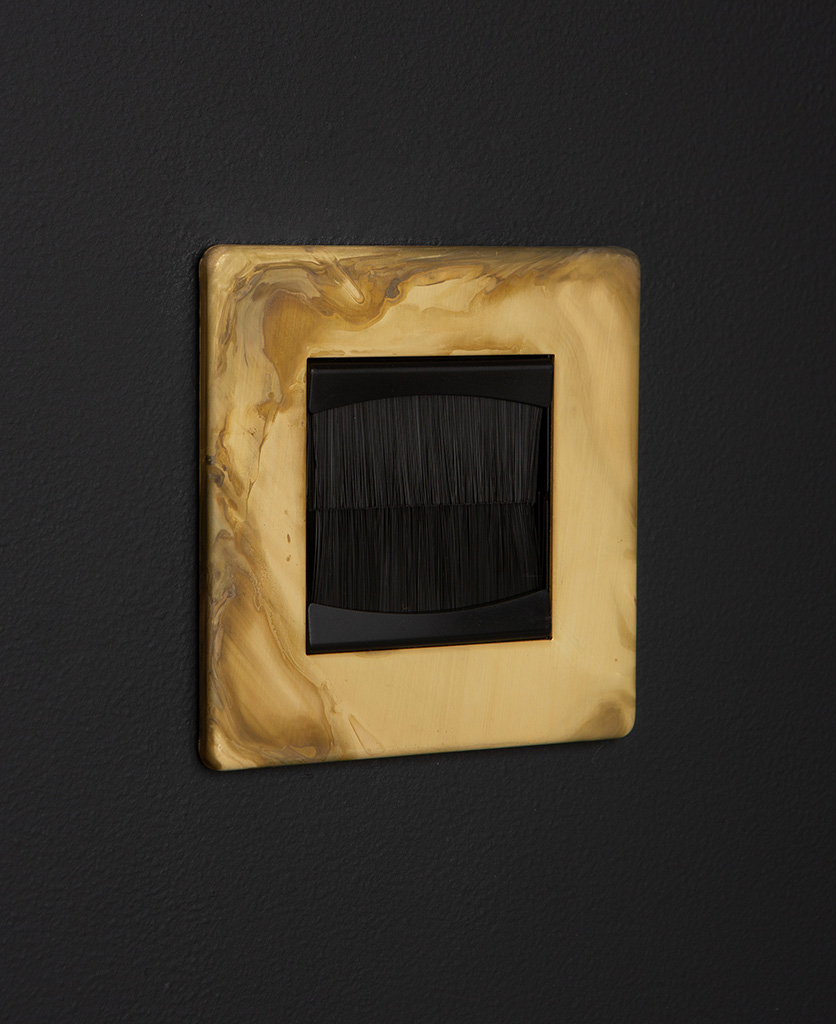 smoked gold & black single brush plate against black background