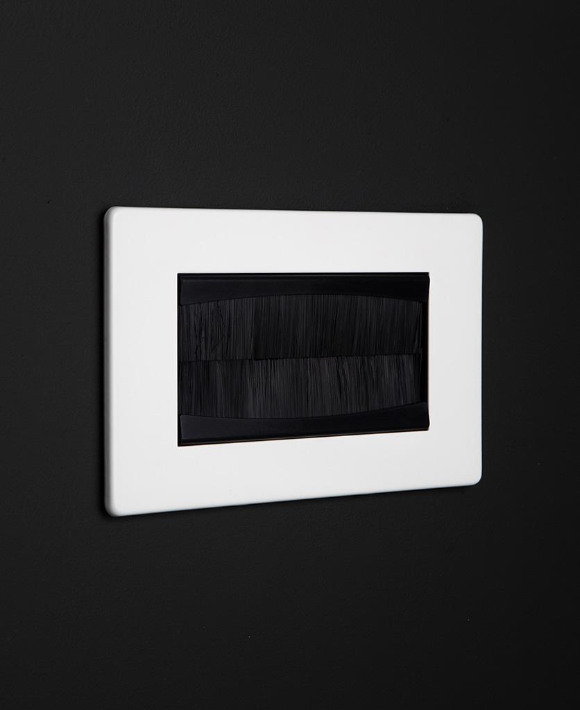white & black double brush plate against black background