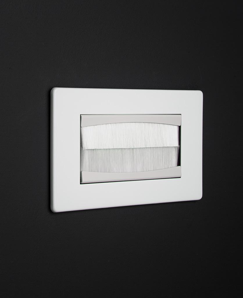 white & white double brush plate against black background